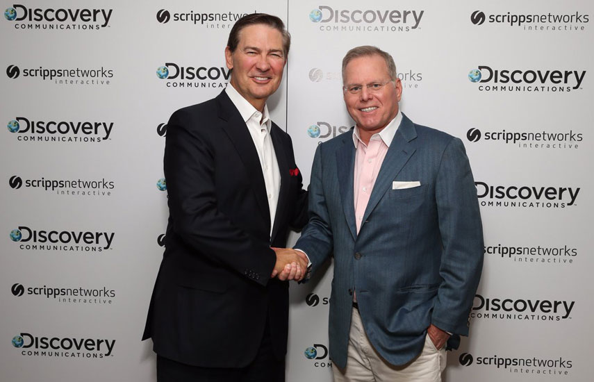 Kenneth W. Lowe, presidente de Scripps Networks Interactive, junto a David Zaslav, presidente y CEO de Discovery Communications.